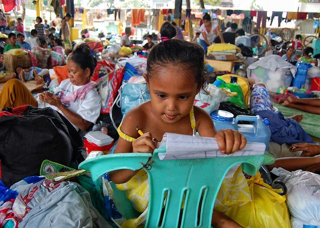Young girl in an evacuation center, 2009. Philippines. Photo: Jerome Ascano / World Bank